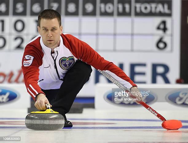 Team Newfoundland/Labrador skip Brad Gushue throws a rock in a game against Team Saskatchewan in the 2011 Tim Hortons Brier Canadian Men's Curling...