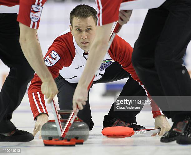 Team Newfoundland/Labrador skip Brad Gushue throws a rock in the 1 vs 2 Page Playoff game against Team Manitoba in the 2011 Tim Hortons Brier...