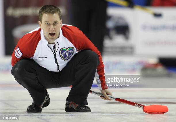 Team Newfoundland/Labrador skip Brad Gushue yells for sweeping in the bronze medal game against Team Alberta in the 2011 Tim Hortons Brier Canadian...