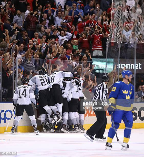 Team North America celebrates after scoring an overtime goal on Team Sweden during the World Cup of Hockey 2016 at Air Canada Centre on September 21...