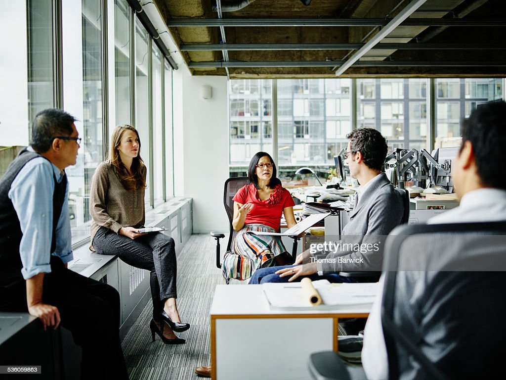 Team of architects having group project discussion : Stock Photo