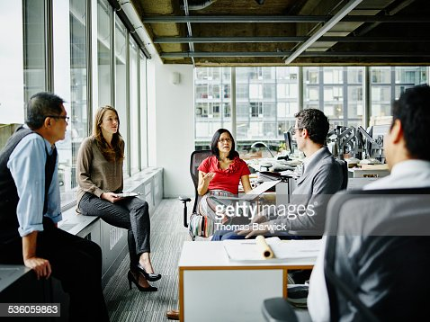Team of architects having group project discussion
