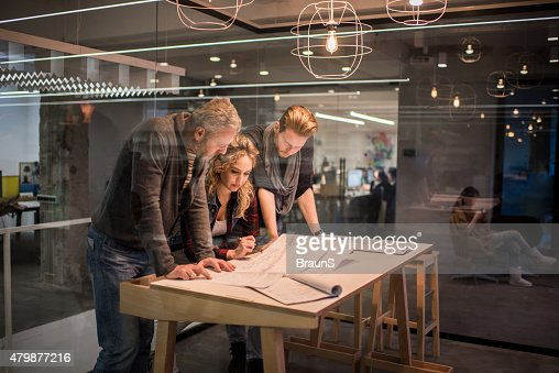 Team of architects working on a new business projects. : Stock Photo