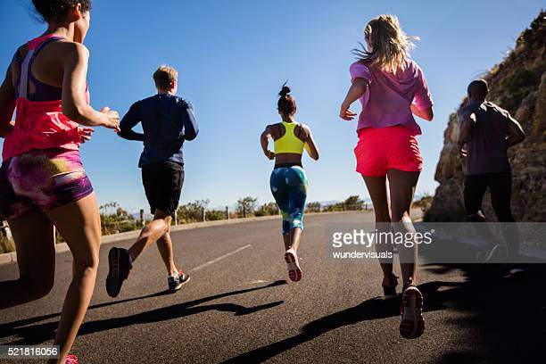 Team of athletes running outdoors on summer