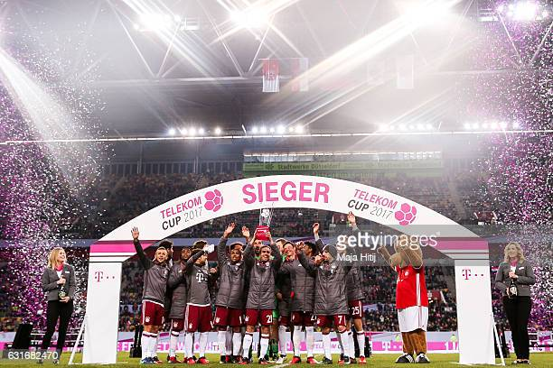 Team of Bayern celebrates with trophy after winning the Telekom Cup 2017 at EspritArena on January 14 2017 in Duesseldorf Germany