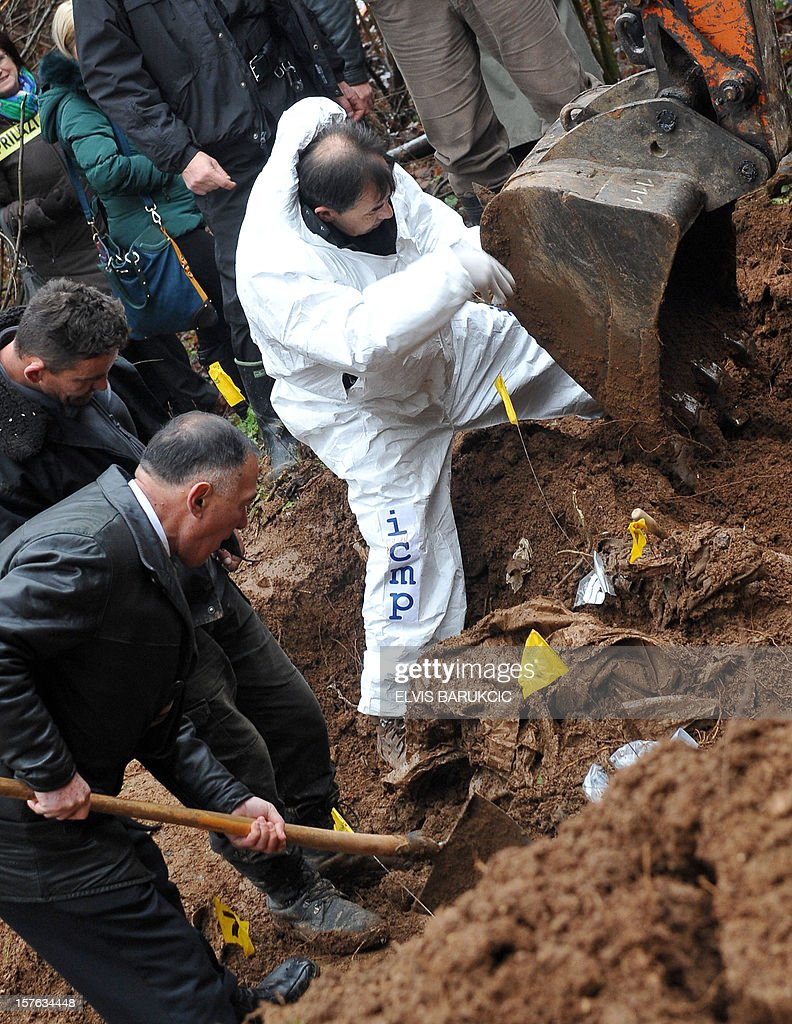 A team of Bosnian forensic experts uncover a potential mass grave site in the village of Misevici, a western suburb of Sarajevo, on December 5, 2012. The forensic team reacted upon an instruction by the Sarajevo District Prosecutor. Only two complete body remains were retrieved on Wednesday, more are expected to be found as the excavation continues. Bodies are believed to belong to Bosnian Muslims killed in the spring of 1992, by Bosnian Serb forces. AFP PHOTO ELVIS BARUKCIC