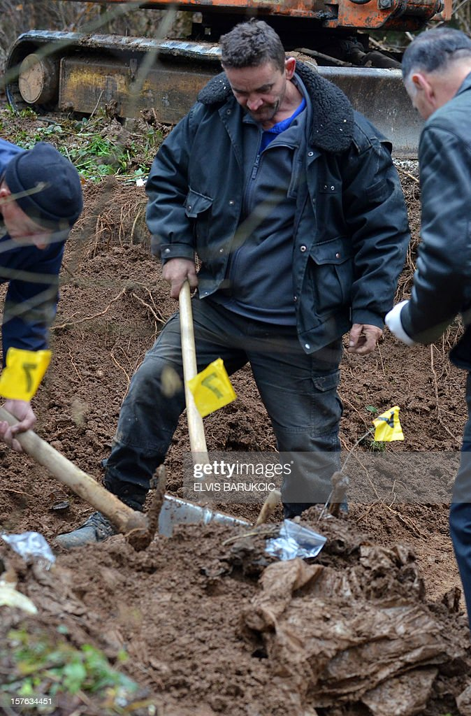 A team of Bosnian forensic experts uncover a potential mass grave site in the village of Misevici, a western suburb of Sarajevo, on December 5, 2012. The forensic team reacted upon an instruction by the Sarajevo District Prosecutor. Only two complete body remains were retrieved on Wednesday, more are expected to be found as the excavation continues. Bodies are believed to belong to Bosnian Muslims killed in the spring of 1992, by Bosnian Serb forces.
