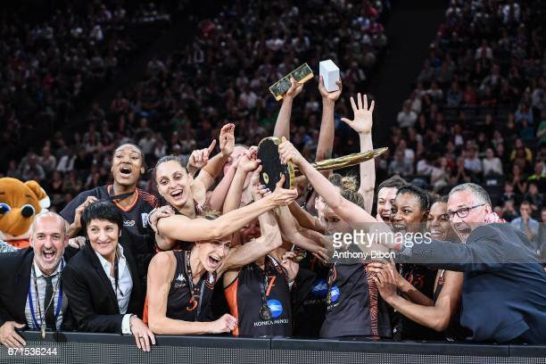 Team of Bourges celebrates the victory with the trophy during the women's Final of the French Cup between Charleville Mezieres and Bourges Basket at...