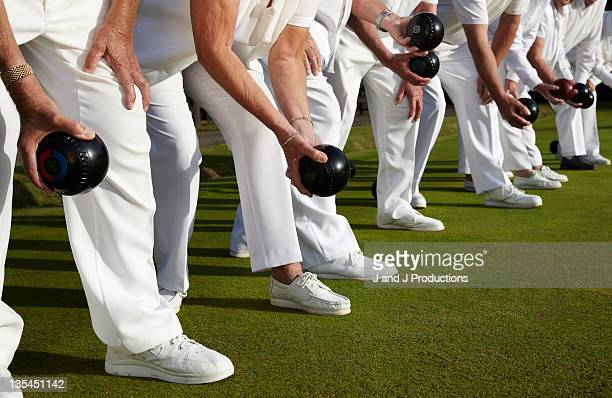 A team of bowls players arms and legs