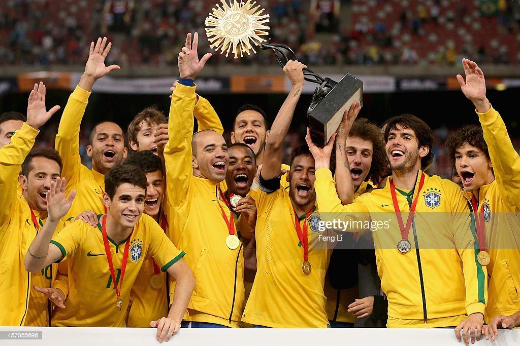 Team of Brazil celebrates winning Super Clasico de las Americas between Argentina and Brazil at Beijing National Stadium on October 11, 2014 in Beijing, China.