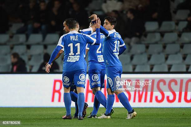 Team of Brest celebrates the first Goal by Neal Maupay during the French LIgue 2 match between Nimes and Brest at Stade des Costieres on December 9...
