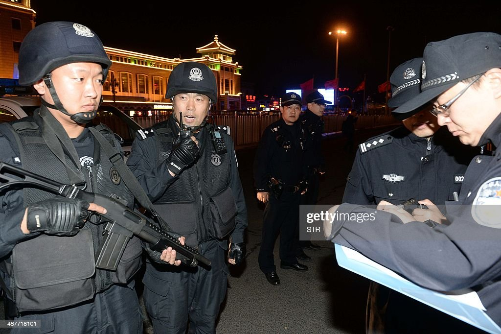 A team of Chinese special police prepare to take up position during a drill outside the railway station in Beijing on the early hours of May 2, 2014. Chinese President Xi Jinping ordered a crackdown after a stabbing spree and explosion at a railway station in the restive Muslim-majority region of Xinjiang left two attackers and a civilian dead and 79 wounded, state media said. CHINA