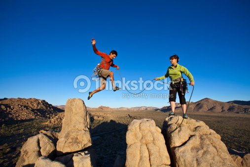 Team of climbers on the summit with ropes : Stock Photo