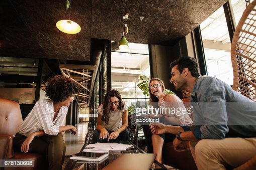 Team of corporate professionals having friendly discussion : Stock Photo