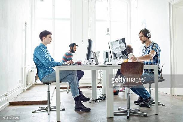 Team of creative people working at startup