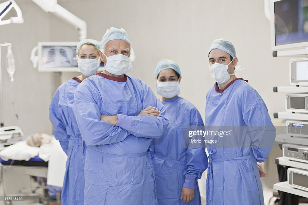 Team of doctors in operating room : Stock Photo