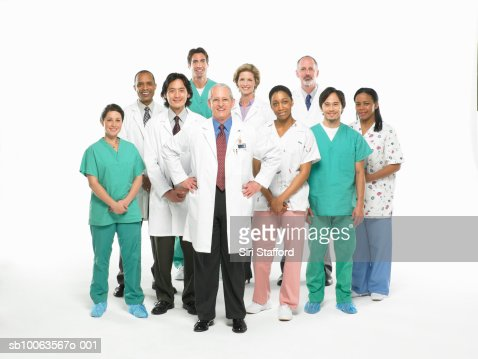 Team of doctors, nurses and surgeons standing on white background, portrait : Stock Photo