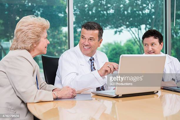 Team of doctors working on diagnosis together during meeting