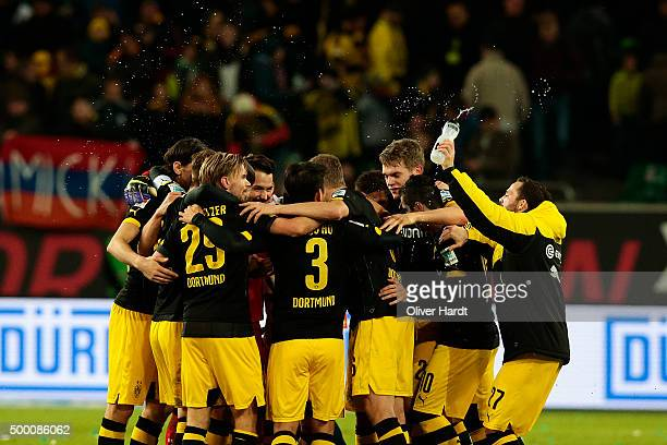 Team of Dortmund celebrate after the First Bundesliga match at between VfL Wolfsburg and Borussia Dortmund at Volkswagen Arena on December 5 2015 in...