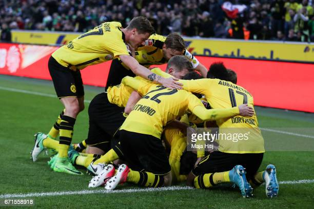 Team of Dortmund celebrates after scoring a goal to make it 23 during the Bundesliga match between Borussia Moenchengladbach and Borussia Dortmund at...