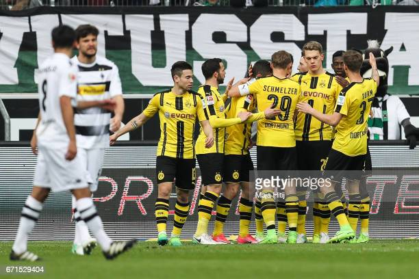 Team of Dortmund celebrates after scoring a penalty shot to make it 01 during the Bundesliga match between Borussia Moenchengladbach and Borussia...