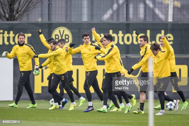 Team of Dortmund warms up during the training of Borussia Dortmund ahead of the UEFA Champions League Round of 16 second leg match between Borussia...