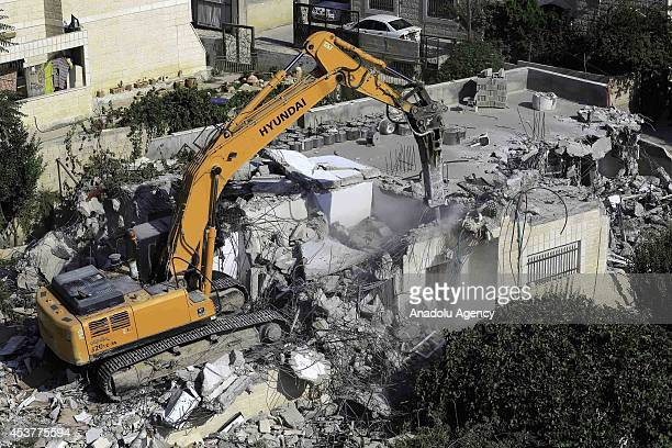 A team of East Jerusalem Municipality demolishes house of Palestinian Tawfiq alGazavi family based on house's being unauthorized building with a...