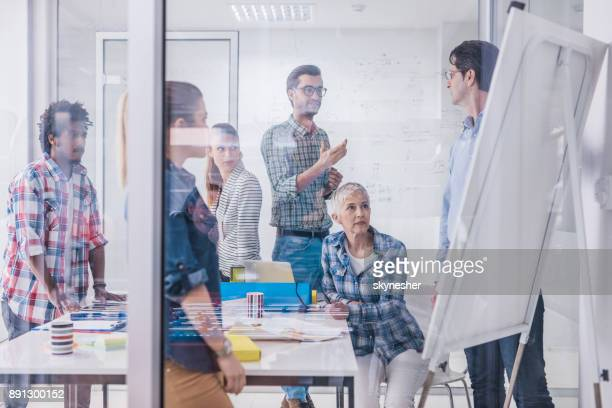 Team of entrepreneurs communicating on a business presentation in the office.
