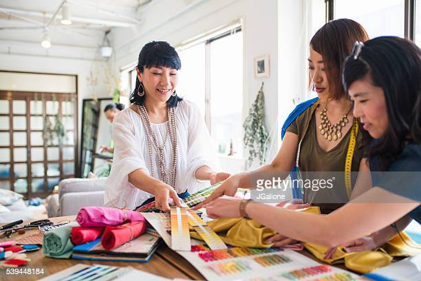 Team of fashion designers looking at colour swatches