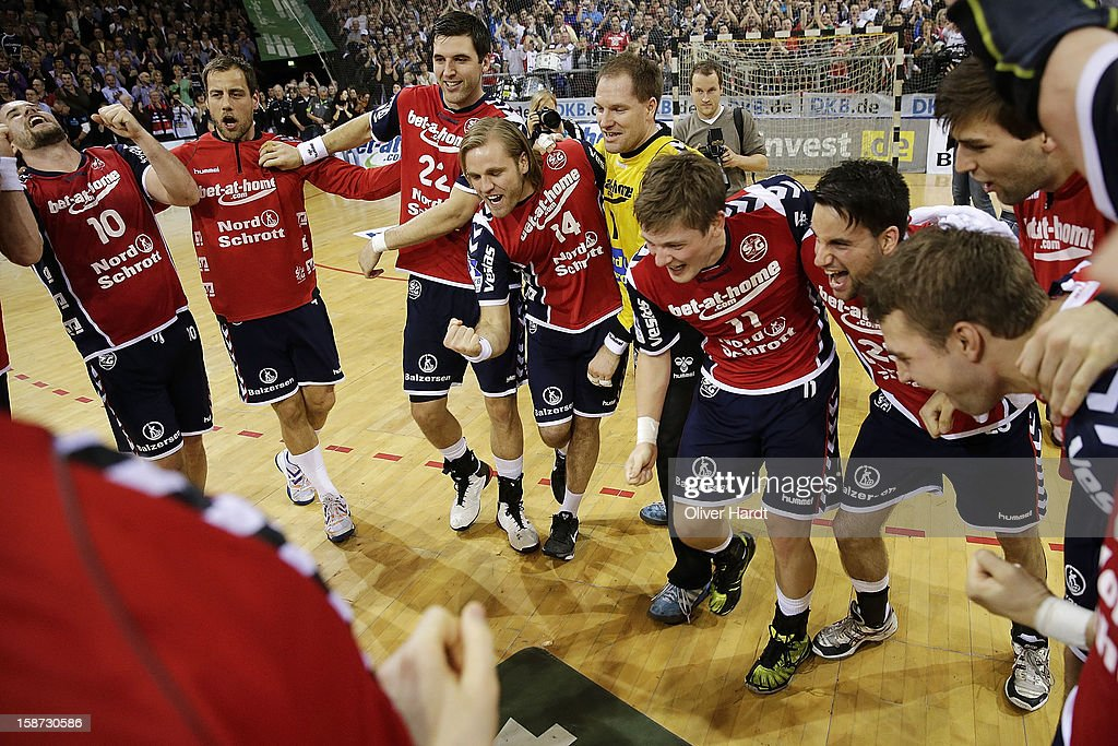 Team of Flensburg celebrate after winning the DKB Handball Bundesliga match between Flensburg-Handewitt and THW Kiel at Campus Hall on December 26, 2012 in Flensburg, Germany.