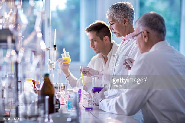 Team of forensic scientists working on an experiment in laboratory.