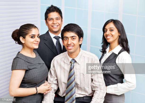 Team of Four Confident Cheerful Indian Business People Person