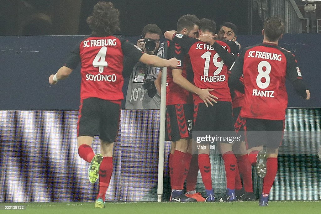 Team of Freiburg celebrate after scoring first goal during the Bundesliga match between FC Schalke 04 and SC Freiburg at Veltins-Arena on December 17, 2016 in Gelsenkirchen, Germany.