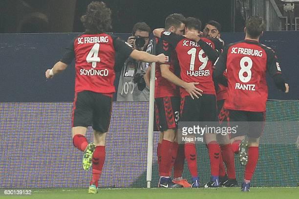 Team of Freiburg celebrate after scoring first goal during the Bundesliga match between FC Schalke 04 and SC Freiburg at VeltinsArena on December 17...