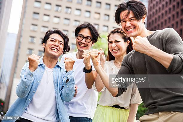 Team of friends cooperating together in Japan