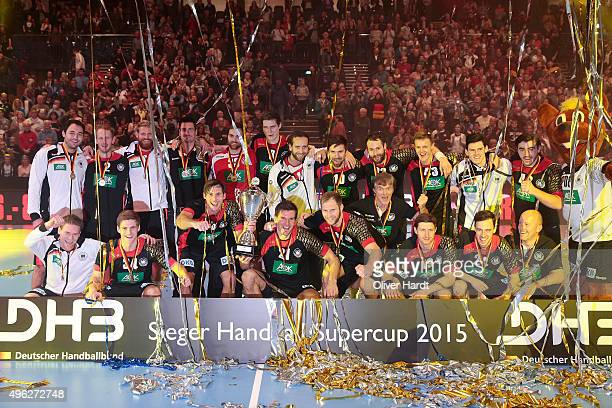 Team of Germany celebrate after the Handball Supercup between Germany and Slovenia on November 8 2015 in Kiel Germany