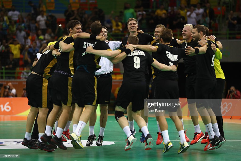 Team of Germany celebrates their victory following the Men's Bronze Medal Match between Poland and Germany on Day 16 of the Rio 2016 Olympic Games at...
