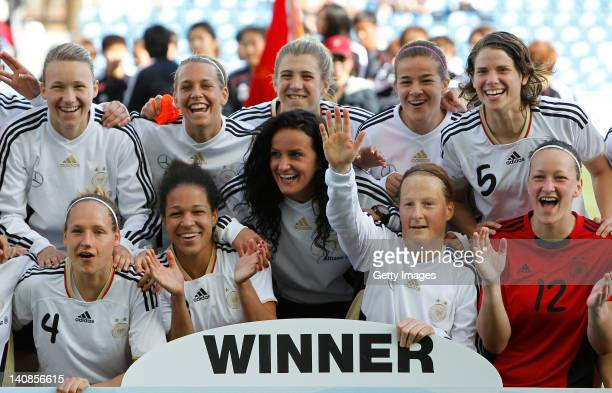 Team of Germany celebrates winning the Algarve Cup 2012 after the final match against Japan on March 7 2012 in Faro Portugal