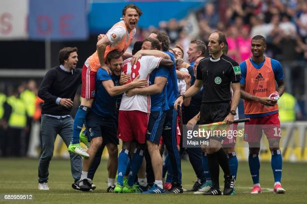 Team of Hamburg celebrates after the Bundesliga match between Hamburger SV and VfL Wolfsburg at Volksparkstadion on May 20 2017 in Hamburg Germany