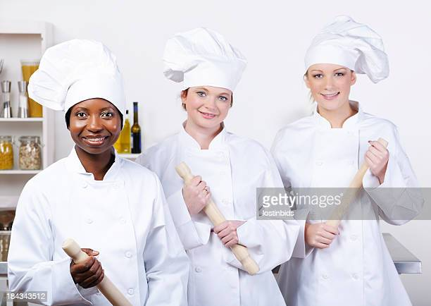 Team Of Happy  Chefs In A Professional Kitchen