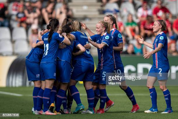 Team of Iceland celebrates after scoring first goal during the UEFA Women's Euro 2017 Group C match between Iceland and Switzerland at Stadion De...