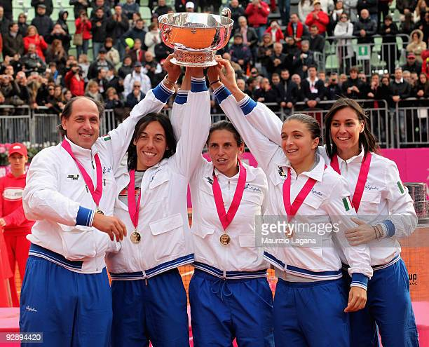 Team of Italy lift the trophy after the final match of the Fed Cup World Group between Italy and the USA at Circolo Tennis Rocco Polimeni on November...