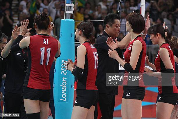 Team of Japan leave after losing the Women's Volleyball semifinal match against team of Brazil on Day 13 of the London 2012 Olympics Games at Earls...