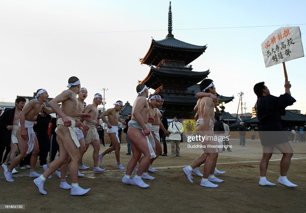 Team of Japanese men wear loincloths as they run around the Saidaiji Temple during Naked Festival on February 16, 2013 in Okayama, Japan. Saidaiji Naked Festival (Hadaka Matsuri) is one of Japan's more eccentric festivals and sees some 9,000 men take part and battle to grab for pair of lucky sticks thrown by priests.