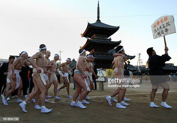 Team of Japanese men wear loincloths as they run around the Saidaiji Temple during Naked Festival on February 16 2013 in Okayama Japan Saidaiji Naked...