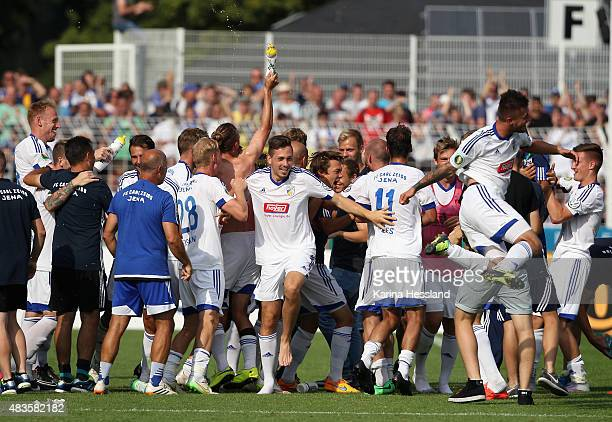 Team of Jena celebrates the victory after the First Round of DFBCup between FC Carl Zeiss Jena and Hamburger SV at ErnstAbbeSportfeld on August 09...