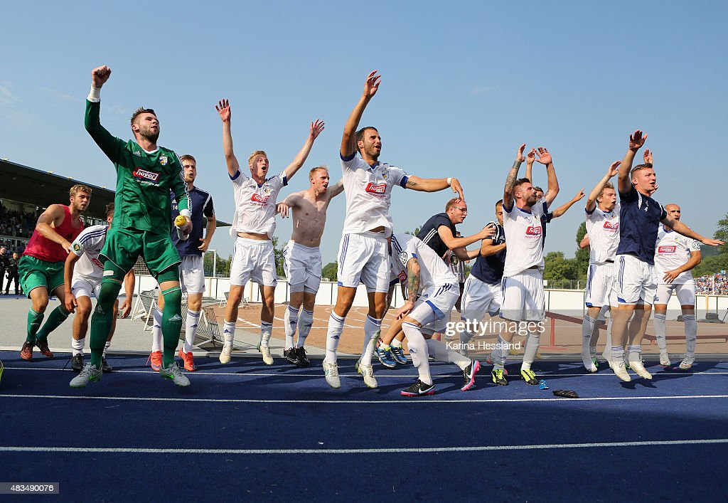Team of Jena celebrates the victory during the First Round of DFBCup between FC Carl Zeiss Jena and Hamburger SV at ErnstAbbeSportfeld on August 09...