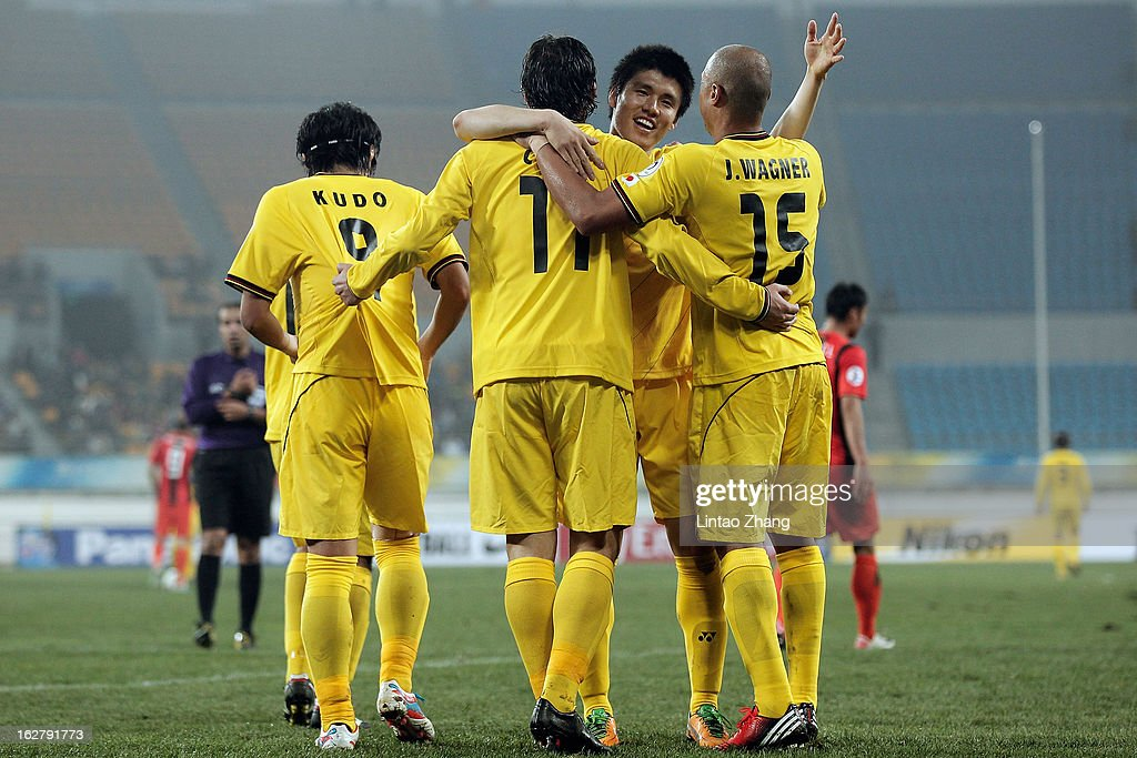 Team of Kashiwa Reysol celebrates scoring their first goal during the AFC Champions League match between Guizhou Renhe and Kashiwa Reysol at Olympic Sports Center on February 27, 2013 in Guiyang, China.