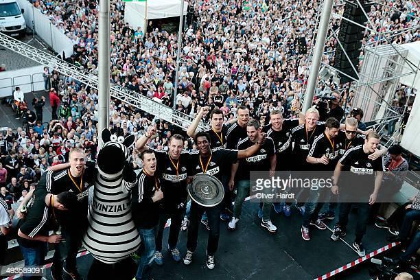 Team of Kiel pose with the trophy at the THW Kiel Victory Parade after winning the DKB Handball Bundesliga on May 24 2014 in Kiel Germany