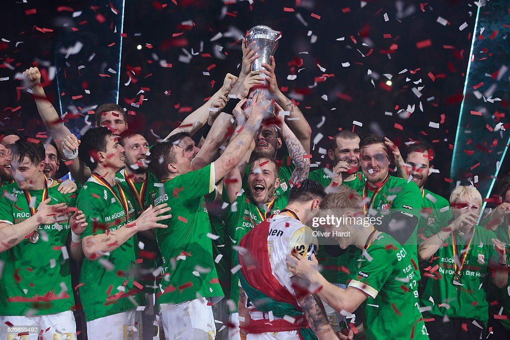 Team of Magdeburg celebrate with the trophy after winning the DKB REWE Final Four Finale 2016 between SG Flensburg Handewitt and SC Magdeburg at Barclaycard Arena on May 1, 2016 in Hamburg, Germany.